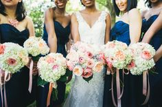 Wedding - cream, peach and pink palette. Garden roses,  hydrangeas and ranunculas in bouquets tied with ribbons.