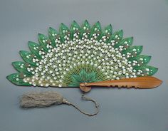 Folding fan with blades in the shape of flowers and leaves of lily of the valley  Austria. The end of the 1860s.  Wood, pearl, silk thread, paint, thread. (Belonged to Empress Maria Feodorovna, wife of Alexander III).