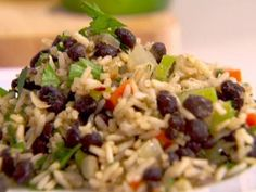 Rice and Black Bean Pilaf   1 cup brown rice, uncooked 2 1/4 cups low-sodium chicken broth 1 tablespoon olive oil 1 small onion, diced (1 cup) 2 cloves garlic, minced 2 teaspoons fresh chopped oregano or 1 teaspoon dried 1 stalk celery, finely diced 1 large carrot, finely diced 1 teaspoon ground cumin 1/2 teaspoon dried chili flakes 1 (15.5 ounce) can low-sodium black beans, drained and rinsed