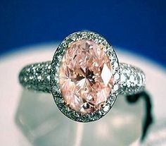Oval peach sapphire instead of a diamond
