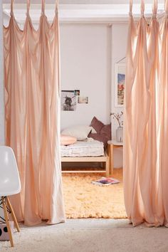 Blush curtains used as a room separator. Knotted Window Curtain at Urban Outfitters (affiliate)