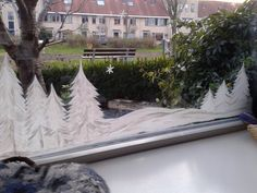 Wintertafereel op de ramen