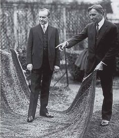 US President Calvin Coolidge (left) receiving the rug from John H. Finley as a gift from the Armenian orphans.