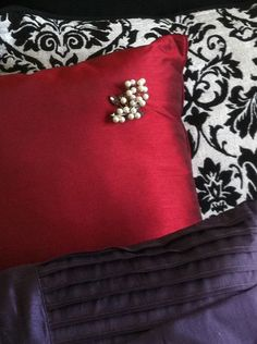 Simple: Add a broach to a throw pillow for some character...