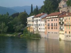 Houses perched along the river in Bassano Del Grappa, Italy