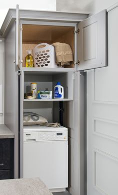 This You Draw It cabinet allows room for a washer and dryer combo to fit perfectly in this cabinet. The pocket doors allow the doors to stay open while washing and to close when not needed. Store your linens and detergent up top on the shelf for easy access! #KBIS2016