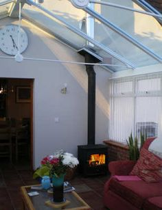 Wood burner in a conservatory setting