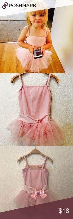 Capezio Toddler camisole pink shimmer tutu dress Capezio toddler girls. Super fun glitter tulle tutu on nylon camisole dress. Perfect for any studio and every recital. Fully lined front bodice. Detailed skirt waistband with faux ribbon belt and bow. Great for dress up too! Condition: Very minor small discoloration on bodice (pictured). Materials: Bodice: 90% Nylon, 10% Spandex; Skirt: 100% Nylon. Measurements:  Happily given upon request. Capezio Costumes Dance