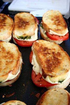 french bread, mozzeralla cheese, tomato, pesto.