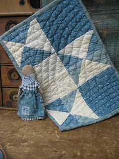 Antique Blue and White Doll Quilt that was salvaged from a larger Ohio Star quilt.