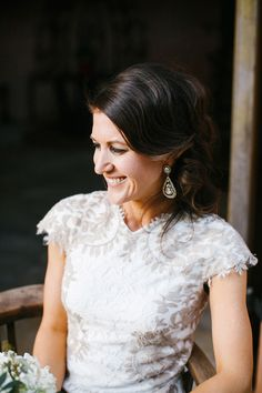 wedding gown with grey lace detail, photo by Awake Photography http://ruffledblog.com/one-world-theatre-wedding #weddingdress #bridal #weddinggown
