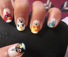 Angry birds nail art, watch the tutorial here: http://www.youtube.com/watch?v=dW46uC1qouc