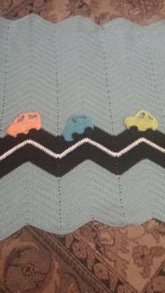 Light blue crochet baby blanket with neon orange blue and green cars (45.00 USD) by MyCrochetedBlankets