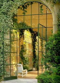 Holy moly these jasmine-draped glass doors are gorgeous!