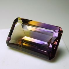A large, emerald cut Ametrine with excellent contrast of deep purple Amethyst with yellow Citrine.