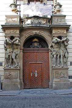 Prague, Czech Republic~ Door 4 photo by ahisgett, via Flickr~ Entrance to Clam Gallas Palace with sculpture of Hercules