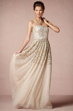Gold and silver sequins against a skirt of nude tulle #weddingdress #tulleskirt