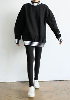 Black sweater w/ stripes / black skinnies / white trainers
