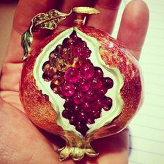 Pomegranate made of gold, rubies and emeralds