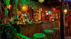The Tiki Bar is a themed watering hole famous for powerful, exotic cocktails (Mai Tais, Zombies). The classic Tiki Bar often boasts bamboo structures with thatch roofs, Tiki God carvings, tropical.