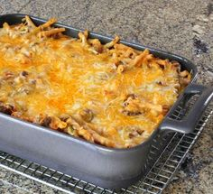 This easy and rich layered main dish recipe for Sicilian Casserole starts with a pound of ground beef and adds a cream cheese sauce and tomato sauce.