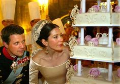 Danish Crown Prince Fredrick and his bride Princess Mary Donaldson viewing their wedding cake on May 14, 2004.