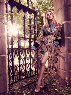 The model poses in brocade and crystal coat from Miu Miu with heels and shorts…