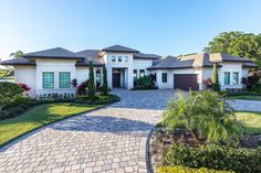 Florida House Plan with Open Layout - 86020BW | 1st Floor Master Suite, Butler Walk-in Pantry, CAD Available, Den-Office-Library-Study, European, Florida, Luxury, MBR Sitting Area, PDF, Photo Gallery, Premium Collection, Split Bedrooms | Architectural Designs