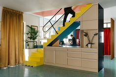 Memphis Colors Meet Greek Details in This Charming Home - Renovations - Curbed National - stairs as a room divider very cool