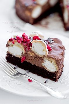 chocOlate cake with chocolate mousse and cream profiteroles More