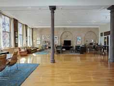 Oh how i wish i had an apartment like this! High ceilings, big windows, exposed brick wall, lots of space....love.