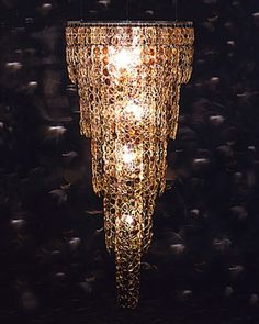This chandelier, called Spectacle, was made by Stuart Haygarth. Spectacle is created from over 1,000 pairs of prescription spectacles which are linked together to resemble a traditional tiered chandelier. from poshposh.com