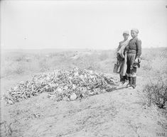 Native Greek children standing by the bones of deceased soldiers who died during the 1915 Gallipoli Campaign that have been collected on Hill 60, Anzac Cove in 1919   WWI   Via: photosofwar in War Images