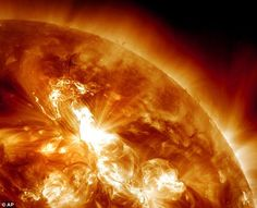 Solar flare erupting on the Sun's northeastern hemisphere, the strongest solar storm in more than six years is bombarding Earth (Jan 2012)