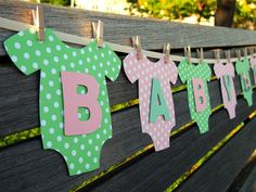 """Onesie """"BABY GIRL"""" Decoration Package: Pink/Green Banner, Cupcake Toppers, and Garlands for Baby Showers/Birthday Parties. $51.95, via Etsy."""