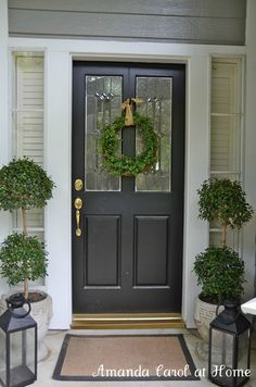 Our porch and door Topiary balls, $30 each at Home Depot- another black door front porch I like