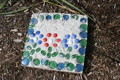 Cement Stepping Stones-- quick drying cement and glass stones. Great project idea for daddy and the kids