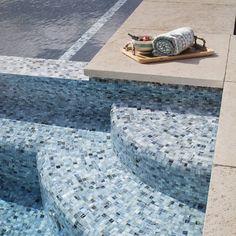 It's all in the details. Featuring Agate 1 x 4 in Umbria Pearl Santa Rosa Pool.  .  .  .  .  .  #tile #tiles #tiled #tiling #tilework #tileaddiction #glasstile #mosaics #tiledesign#tilelove #pooldesign #pool #bluetiles #blue #instablue #outdoorliving #summer