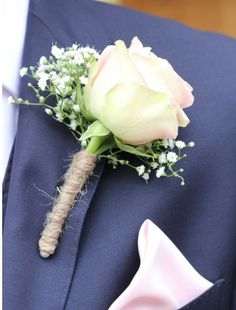 Rose groom button hole