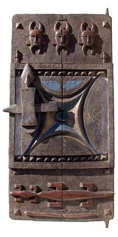 Africa | Although less well known than their masks and figures, Senufo doors share their iconography. This example in low relief on double (fastened with iron staples) panels depicts lizards and masks and includes a doorlock. | © Tim Hamill