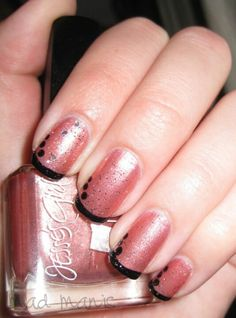 Black french on pink nail polish