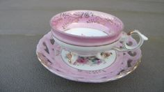 Vintage Pink Rose Three Footed Tea Cup and Saucer. Japan  I just bought this set last weekend.  :)