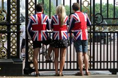 July 22 2013 ~  Patriotic well-wishers at Buckingham Palace.  Photo By PA