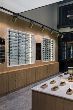 "View the full picture gallery of ""Tagarelis"" Optical Culture Optometry Office, Eyewear Shop, Glass Store, Optical Shop, Luxury Store, Clinic Design, Showroom Design, Retail Store Design, Sunglasses Shop"