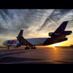 FedEx Express McDonnell Douglas cargo plane / freighter on the runway at sunset Parcel Delivery, Package Delivery, Mcdonnell Douglas Md 11, Mcdonald Douglas, Commercial Plane, Air Photo, Cargo Airlines, Fedex Express, Military Aircraft
