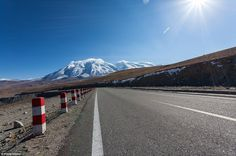 Karakoram Highway: China likes to do things bigger and roads are o different, but here they share the title of world's highest paved international road with Pakistan. The stretch of asphalt crosses the Karakoram mountain range through the Khunjerab Pass at 15,397 feet above sea level