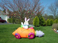 Inflatable Bunny Infront of Easter Tree by jrobertsfamily, via Flickr