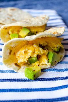 Scrambled eggs with feta and avocado. Creamy and so luscious! Serve it on homemade flour tortillas!   giverecipe.com   #eggs #avocado #feta #breakfast #snack #taco #tortilla