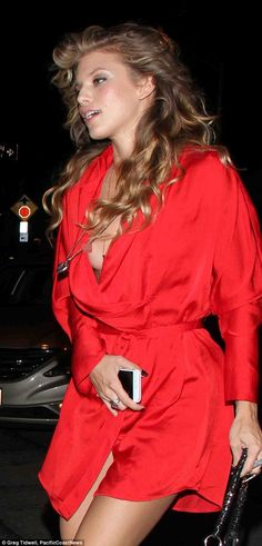 Faux pas: AnnaLynne McCord suffered a wardrobe malfunction as she stepped out at Craig's Restaurant in West Hollywood on Tuesday, her wrap-fronted dress revealing her braless chest underneath