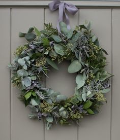 Christmas a door wreath with a mix of herbs and foliage.